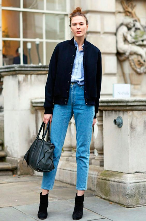 a blue shirt, blue cropped jeans, black booties, a black bomber jacket and a black bag for a simple everyday look