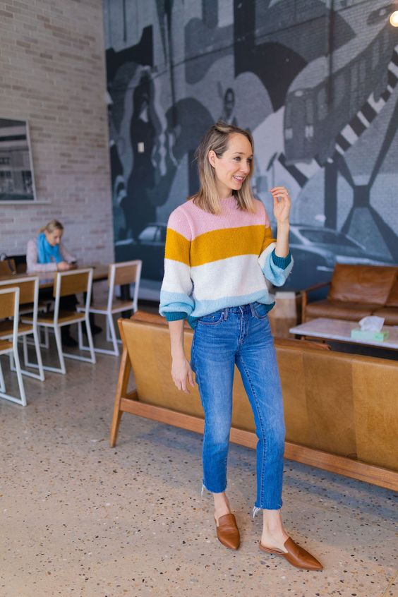 a bold striped jumper, blue slim leg cropped jeans, brown slipper mules are great for a bright fall look