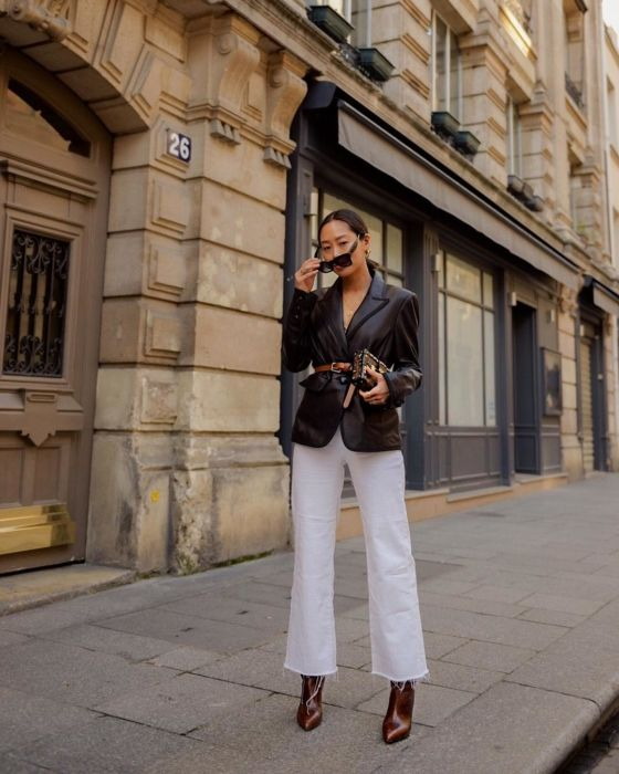 a brown leather blazer, white jeans, burgundy booties and a gold clutch plus an amber leather belt for a bold look