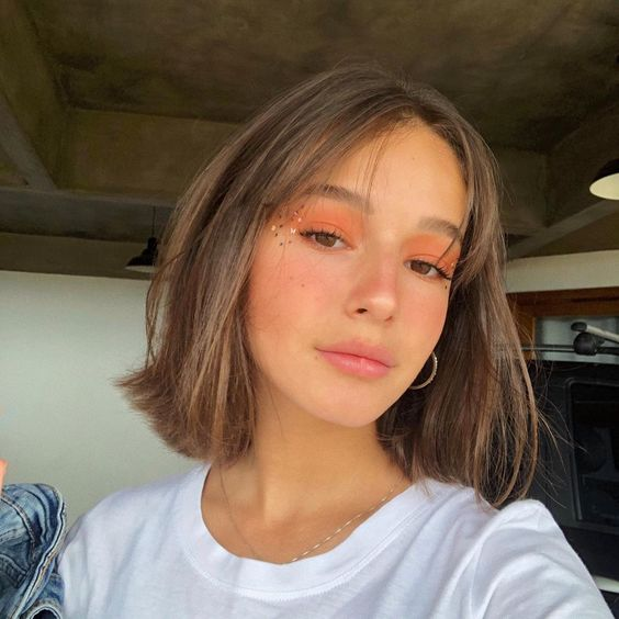 a brunette long bob with curtain bangs is a very cute and sweet idea to rock right now, give your hair some texture or volume