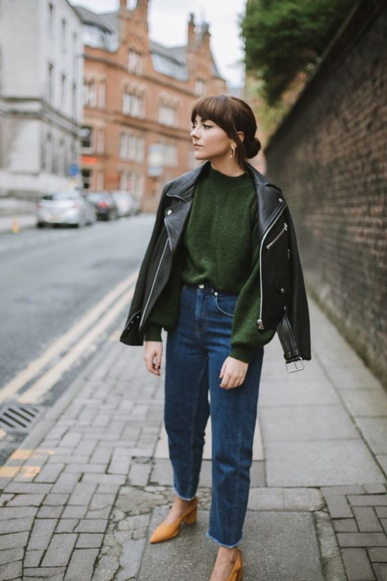 a chic fall look with a green sweater, blue jeans, a black leather jacket, yellow shoes is a gorgeous idea