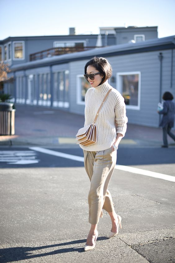 a chunky turtleneck sweater, neutral cropped culottes, neutral shoes and a pretty crossbody bag