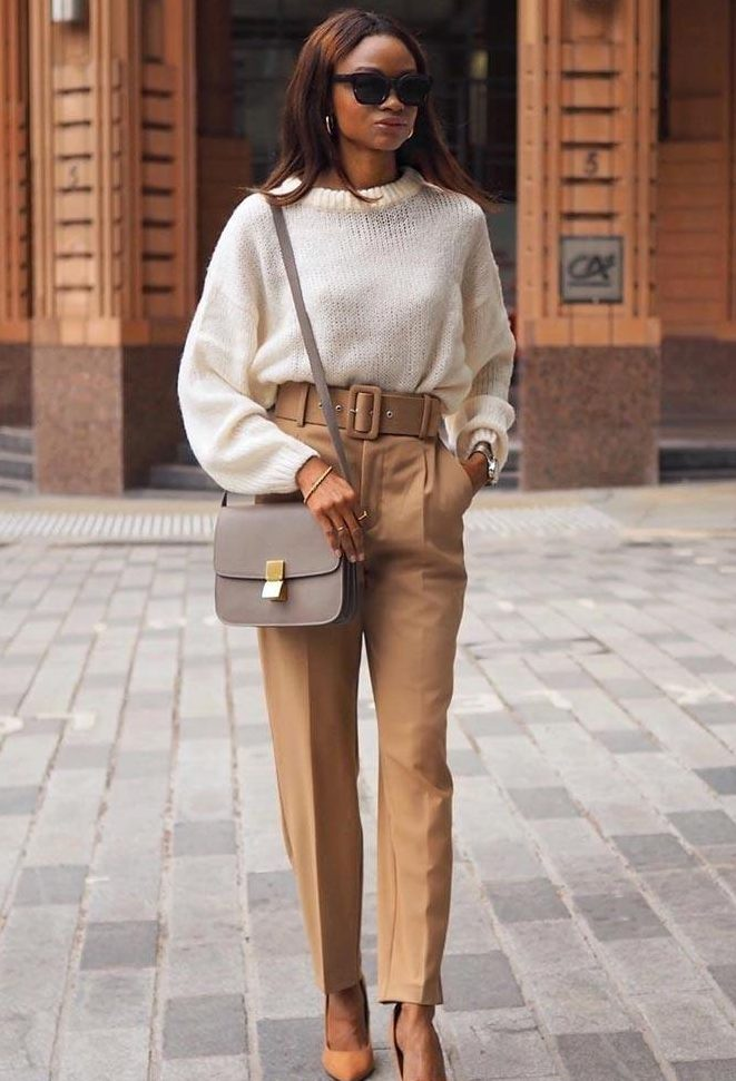 a classy fall work look with a white jumper, tan high waisted trousers with a belt, orange shoes and a grey crossbody bag