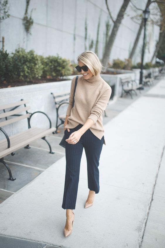 a classy outfit with a tan turtleneck sweater, navy pinstripe trousers, tan heels and a black bag for the fall