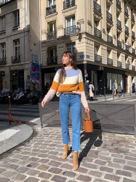 a color block sweater, blue cropped jeans, tan suede boots and a brown bucket bag for a French chic look