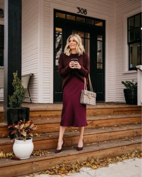 a cozy and girlish look with an oversized burgundy sweater, a slip skirt, heels, a snakeskin print bag