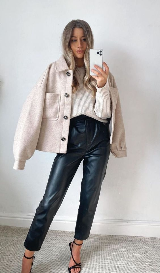 a cozy fall look with leather trousers, a neutral ribbed jumper, a neutral flannel shirt coat and black heels