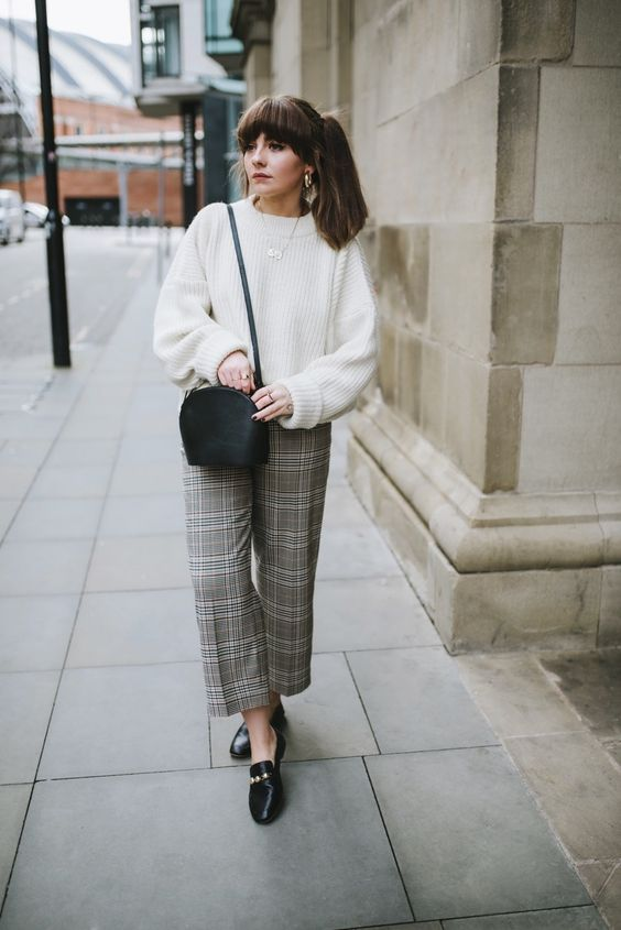 a fall to winter look with a white jumper, grey plaid wide leg trousers, black loafers and a black bag
