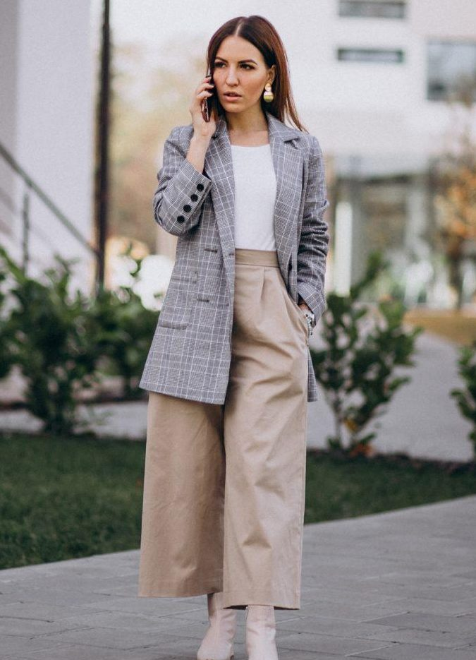 a fall work look with a white t-shirt, an oversized grey blazer, neutral culottes and creamy booties plus statement earrings