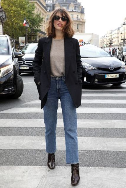 a grey jumper, blue jeans, burgundy booties, an oversized black blazer and a black bag for every day