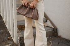 a grey oversized jumper, creamy flare jeans, tan shoes and a dusty pink bag for the fall
