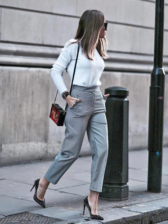 a lovely and stylish fall work outfit with a fuzzy jumper, grey high waisted cropped pants, spiked shoes and a bold bag