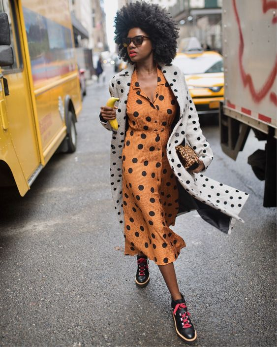 a lovely girlish look with a rust-colored polka dot shirtdress, a white polka dot coat and black sneakers with pink laces
