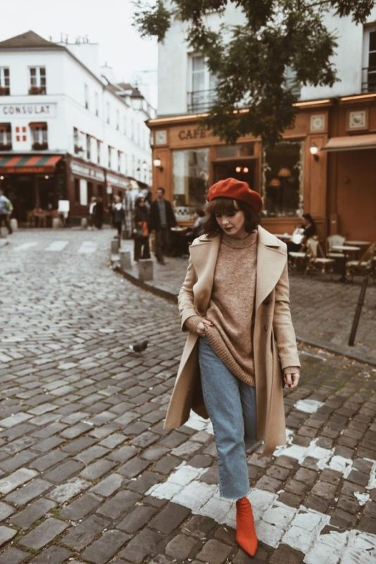 a lovely outfit with a tan oversized jumper, blue cropped jeans, hot red booties and a beret, a tan coat is wow