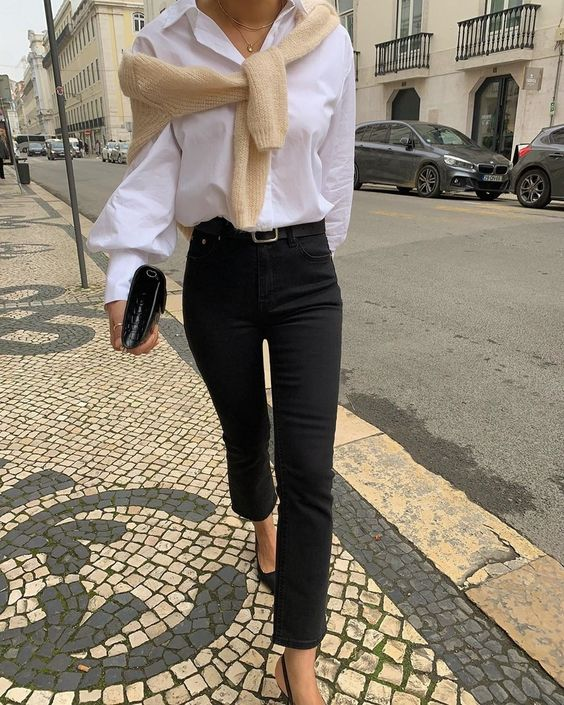 a minochromatic work look with a white shirt, black slim leg jeans, a black belt and slingbacks plus a neutral jumper