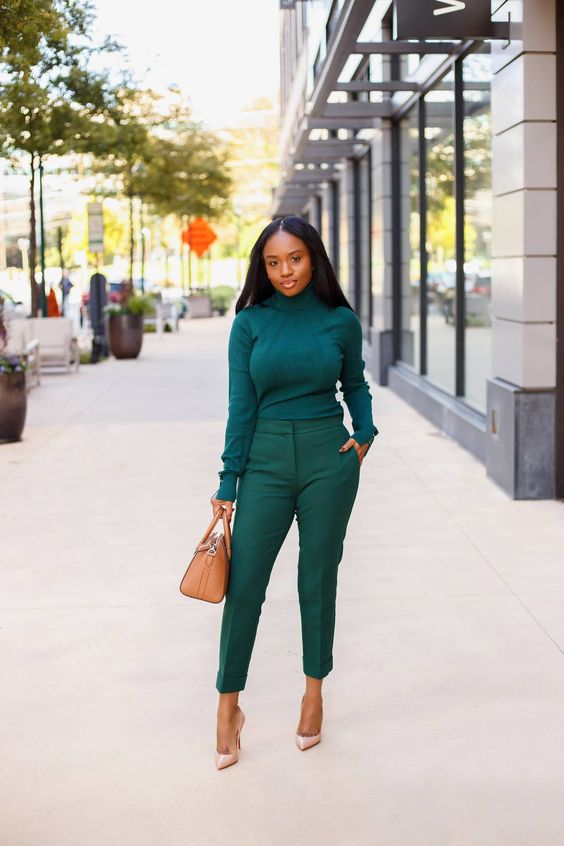 a monochromatic fall look with an emerald turtleneck and pants, blush pumps and a tan bag is simple and cool
