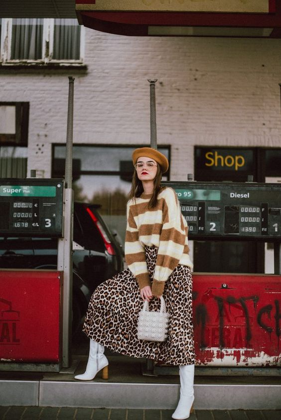 a mustard and white striped sweater, a leopard print midi skirt, white boots, an embellished bag and a mustard beret