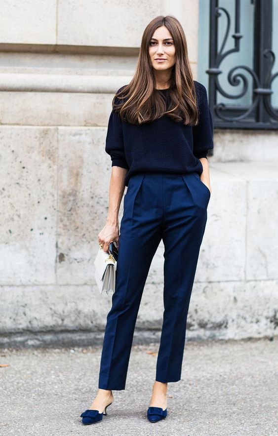 a navy short sleeve jumper, bold blue trousers, matching heels and a creamy bag for an impressive look