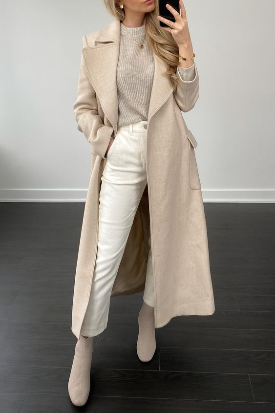 a pretty monochromatic fall outfit with a tan ribbed jumper, white jeans, tan booties, a tan trench is lovely