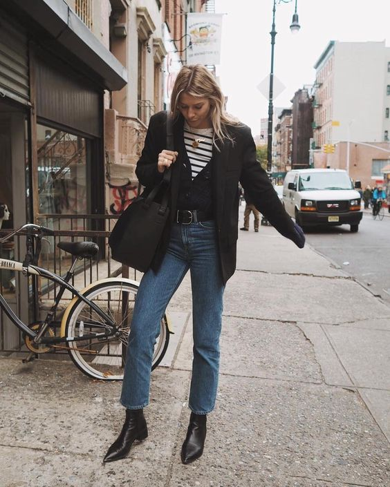 a pretty outfit with a striped t-shirt, a black cardigan, a black blazer, blue slim leg jeans, black boots and a bag