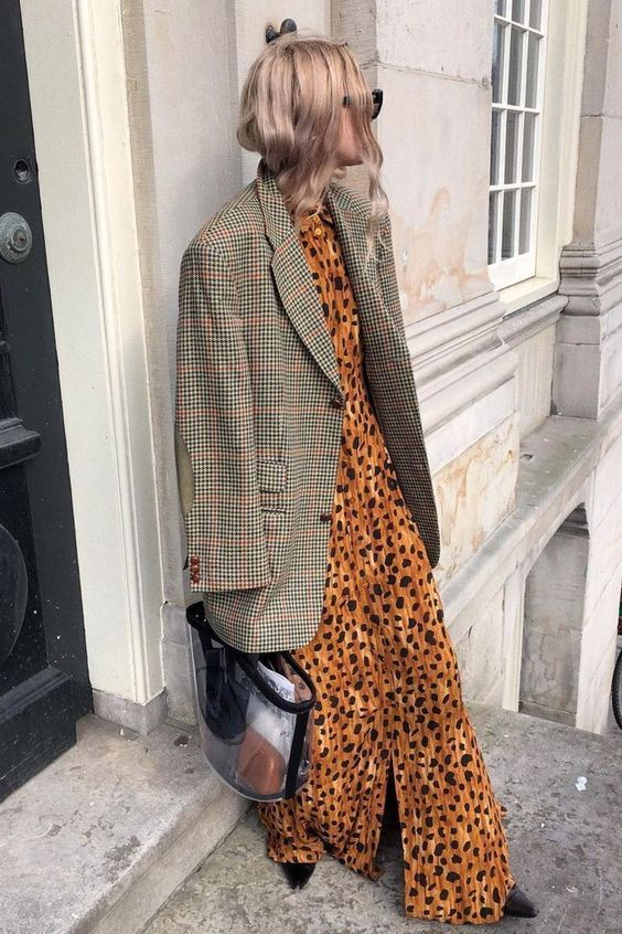 a rust-colored leopard print maxi dress, a grey plaid oversized blazer, black shoes and a clear bag for a trendy look
