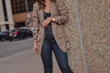 a sexy fall look with a black lace top, black flare jeans, brown snakeskin print boots and a brown blazer