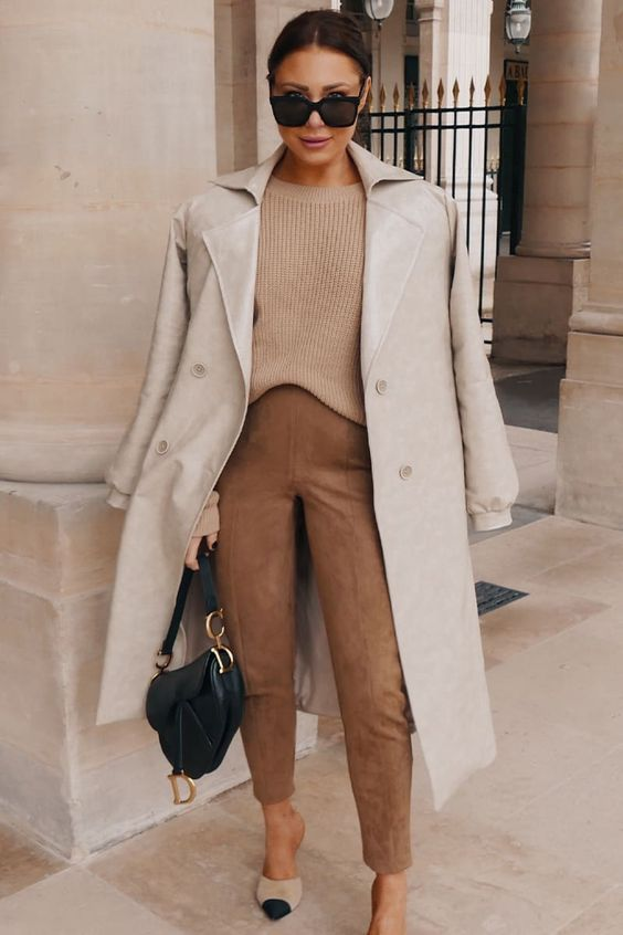 a simple and elegant fall look with a tan jumper, brown suede pants, two tone shoes, a dove grey trench and a black bag