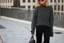 a simple work outfit with a black chunky knit sweater, black flare jeans and boots and a black tote