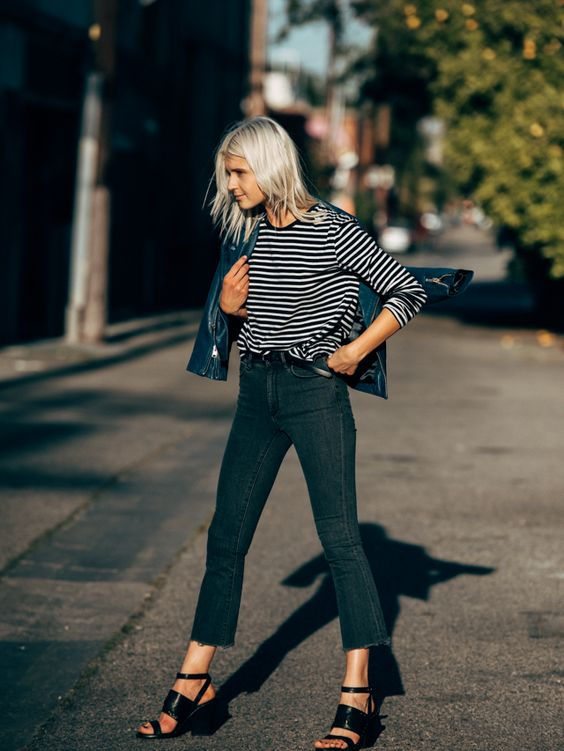 a striped shirt, black flare cropped jeans, black block heels and a blue denim cropped jacket