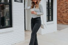 a striped top, black flare jeans, nude heels, a tan hat and a creamy bag for a relaxed boho-inspired look