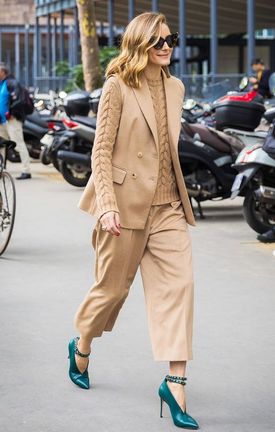 a tan look with a jumper, trousers and a waistcoat accented with gorgeous teal shoes with spiked straps