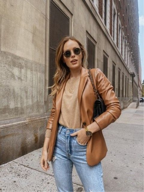 a tan top, blue jeans, an amber leather blazer, a black bag on chain for a simple and fall-inspired outfit