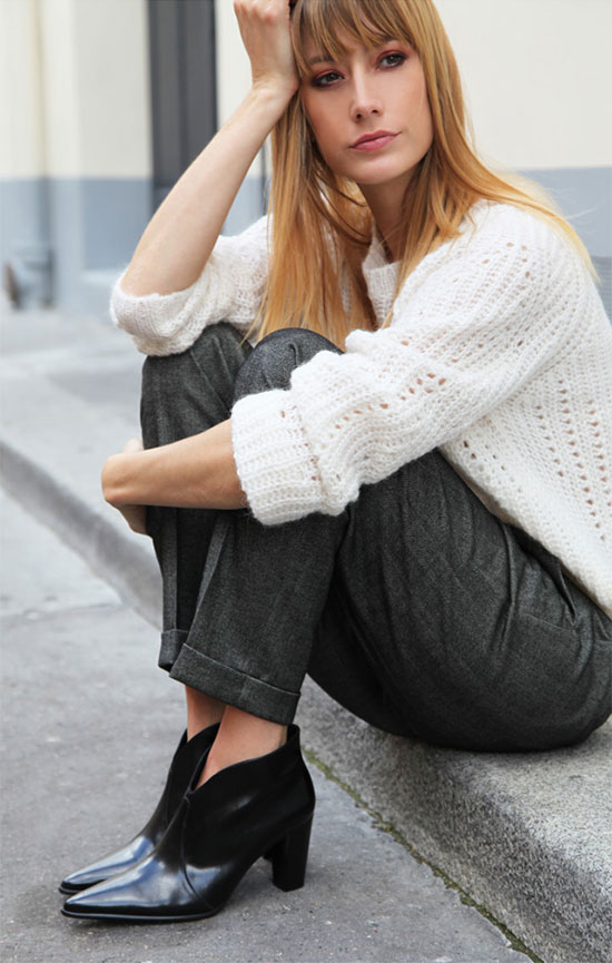 a white chunky jumper, grey trousers, black booties are all you need to feel comfy and look stylish at work