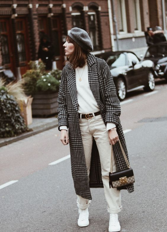 a white jumper, creamy jeans, white sneakers, a plaid coat, a gret beret, a two tone bag