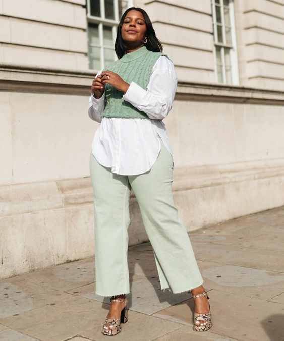 a white oversized shirt, light green jeans, a matching cropped waistcoat, snakeskin print shoes for a catchy look