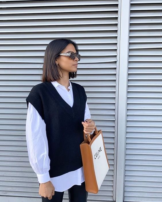 a white shirt, a black knit vest, black leather trousers are a great combo for going to work or just hanging around