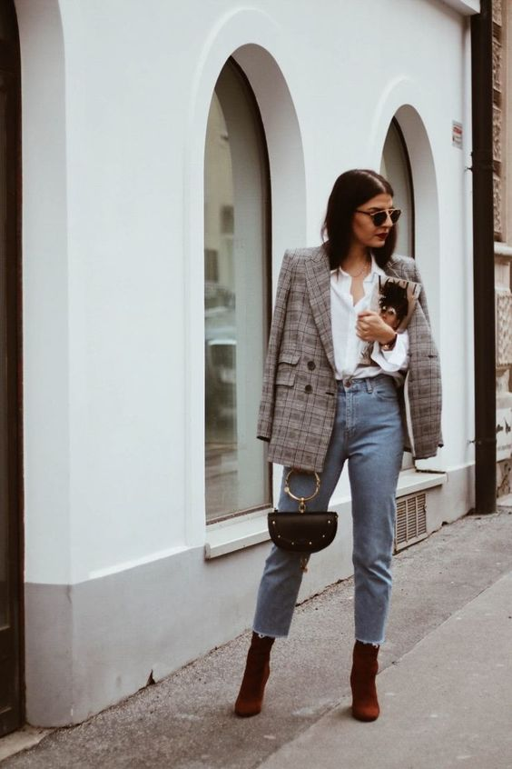 a white shirt, a grey plaid blazer, blue jeans, rust-colored booties and a black bag with a ring handle for work in the fall