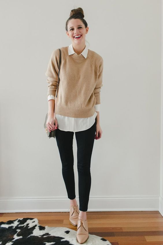 a white shirt, a tan jumper, black leggings, tan Oxford shoes and a grey bag for a stylish and super comfy work look