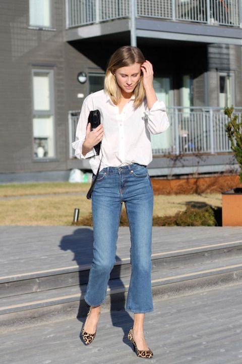 a white shirt, blue cropped flare jeans, leopard print shoes and a black bag for a simple yet bold look