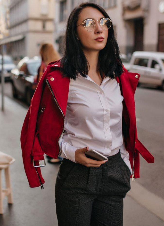 a white shirt, grey trousers are a very simple combo but it's spruced up with a bold red moto jacket for a hot touch
