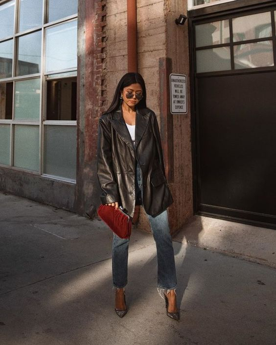 a white top, blue jeans, a black leather blazer, silver shoes and a vintage red clutch for this fall
