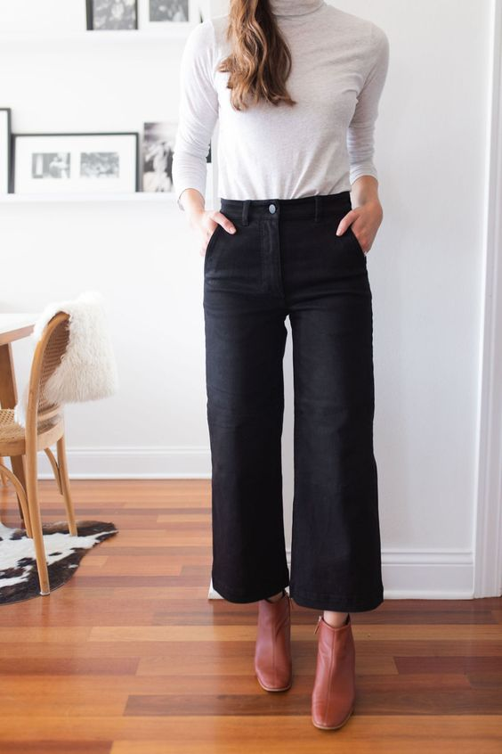 a white turtleneck, black wideleg cropped jeans, orange leather booties compose a very simple work look