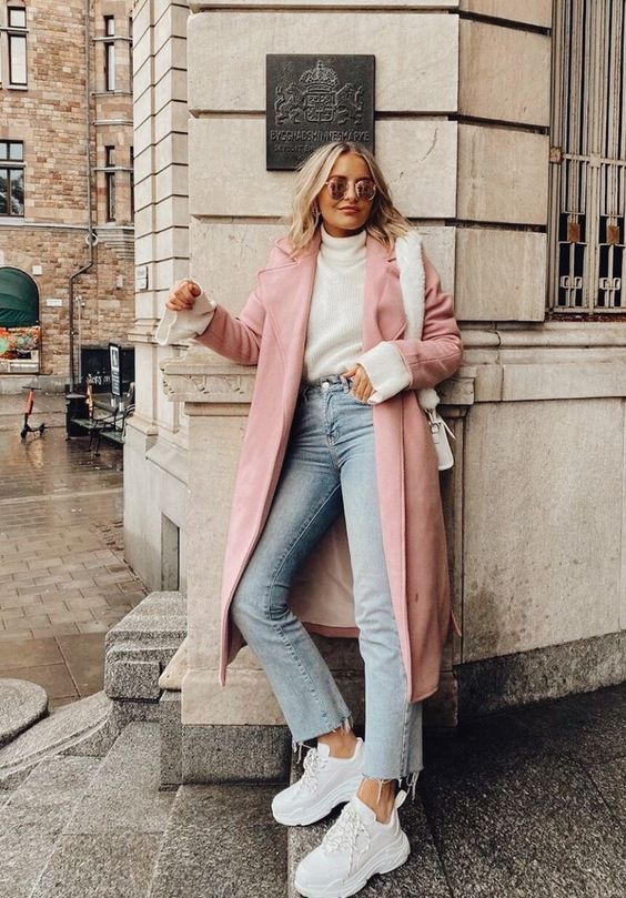 a white turtleneck, white trainers and a bag, a pink coat and light blue slim leg jeans for a cold day