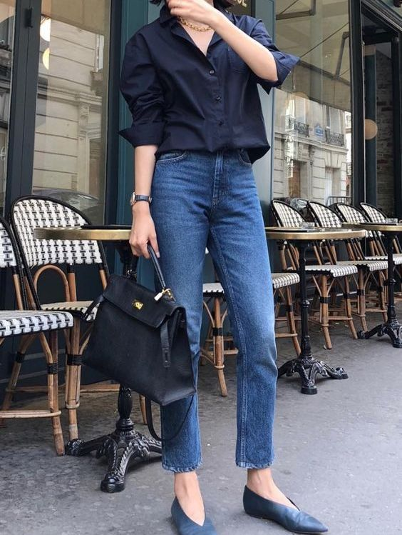 ablack shirt, blue slim leg jeans, navy vintage flat shoes and a black tote are a cool look for work