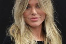 beautiful long blonde hair with curtain bangs and much texture looks catchy, interesting and lovely