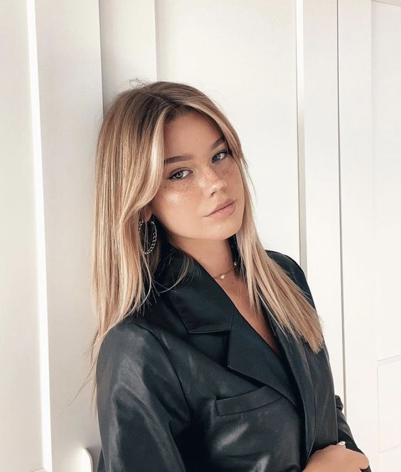 beautiful long hair with icy blonde balayage, a darker root and long curtain bangs is a gorgeous idea