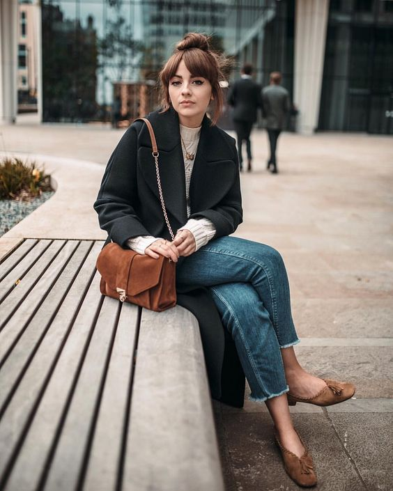 blue jeans, a white jumper, a black cropped coat, brown vintage shoes and a brown suede bag