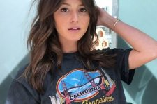 gorgeous brunette medium length hair with waves, with long curtain bangs looks fantastic and beautiful