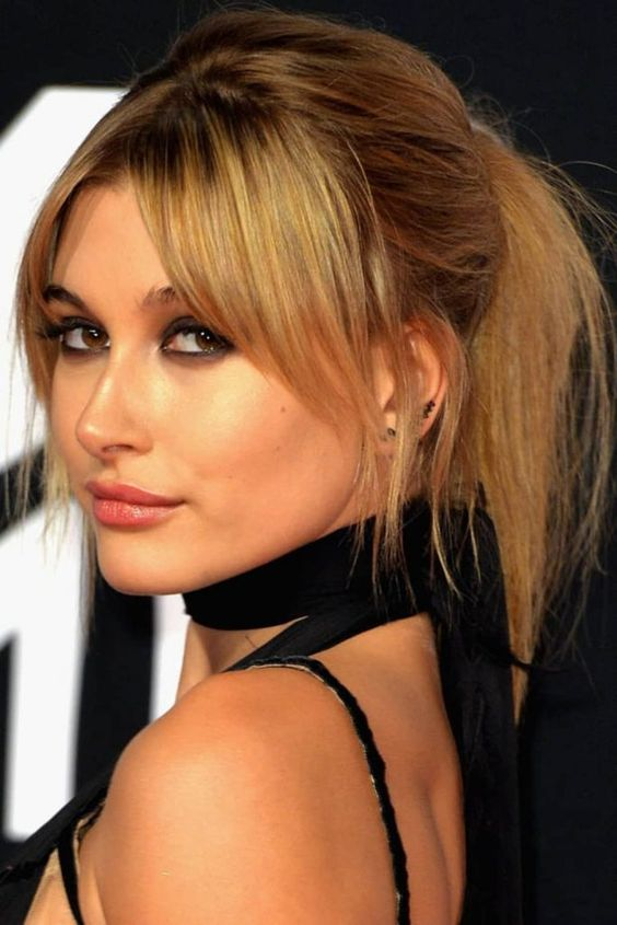 honey blonde hair - a ponytail with a bump and curtain bangs is a gorgeous idea to look cute, soft and chic