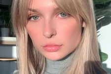 long blonde locks with curtain bangs and plenty of texture are a beautiful idea to rock any time